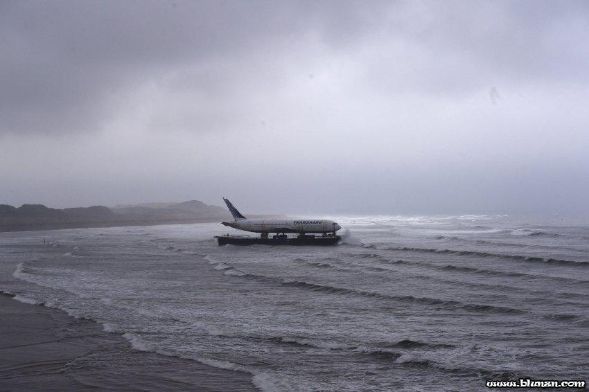 Bad weather surrounds a Boeing 767 airplane as it arrives onto Enniscrone beach after it was tugged from Shannon airport out to sea around the west coast of Ireland, May 7, 2016. It is destined for local funeral director David McGowan's proposed Glamping Village to be used as accommodation in Sligo, Ireland. REUTERS/Clodagh Kilcoyne TPX IMAGES OF THE DAY